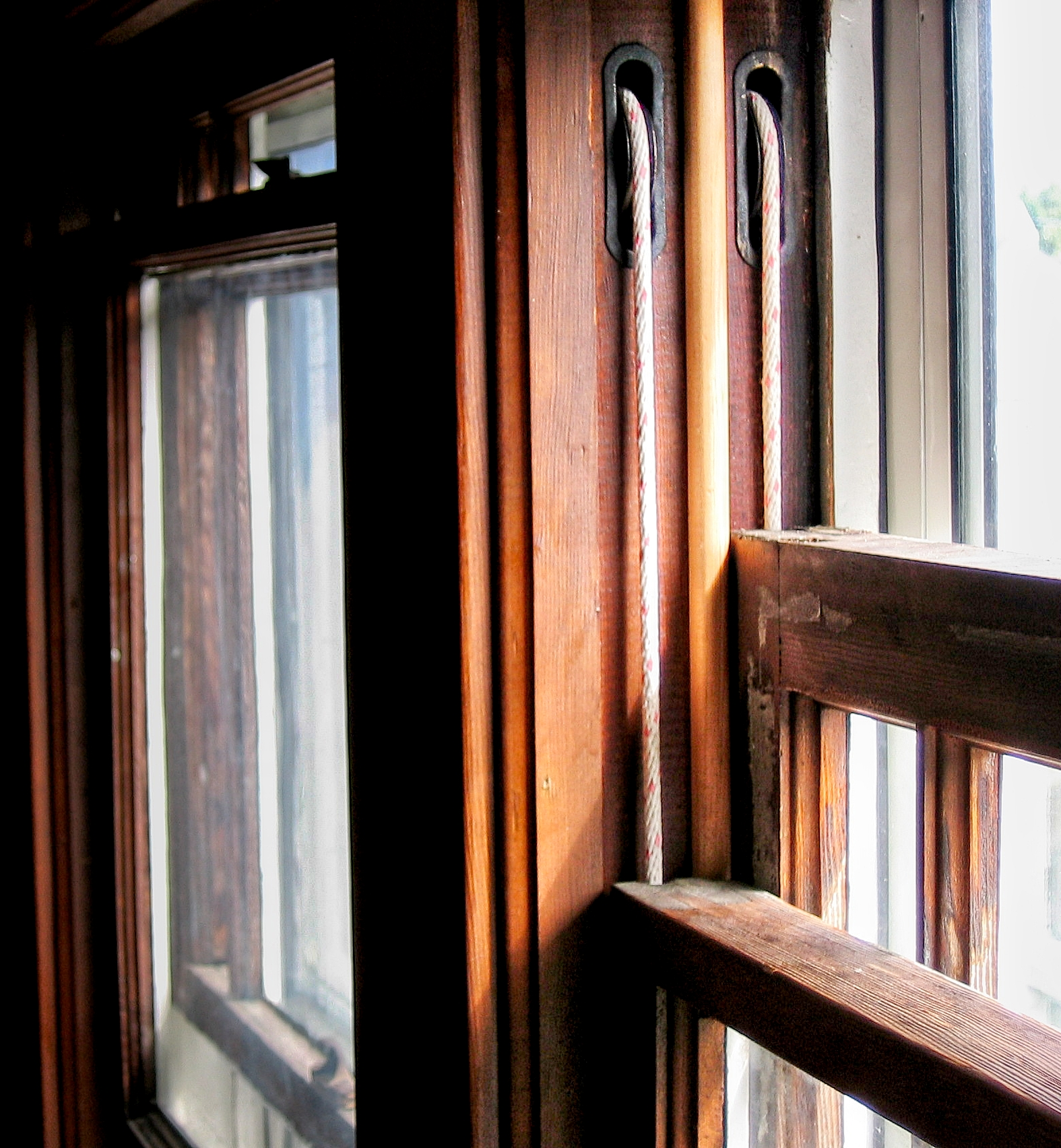 After. This window is now equipped with new, strong sash cords. And both sash will open again.